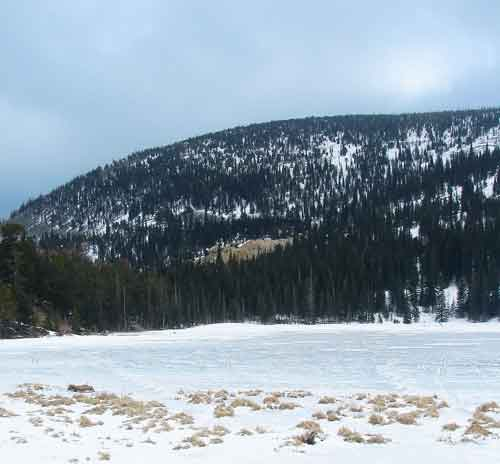 The frozen lake with mine tailings in the background.